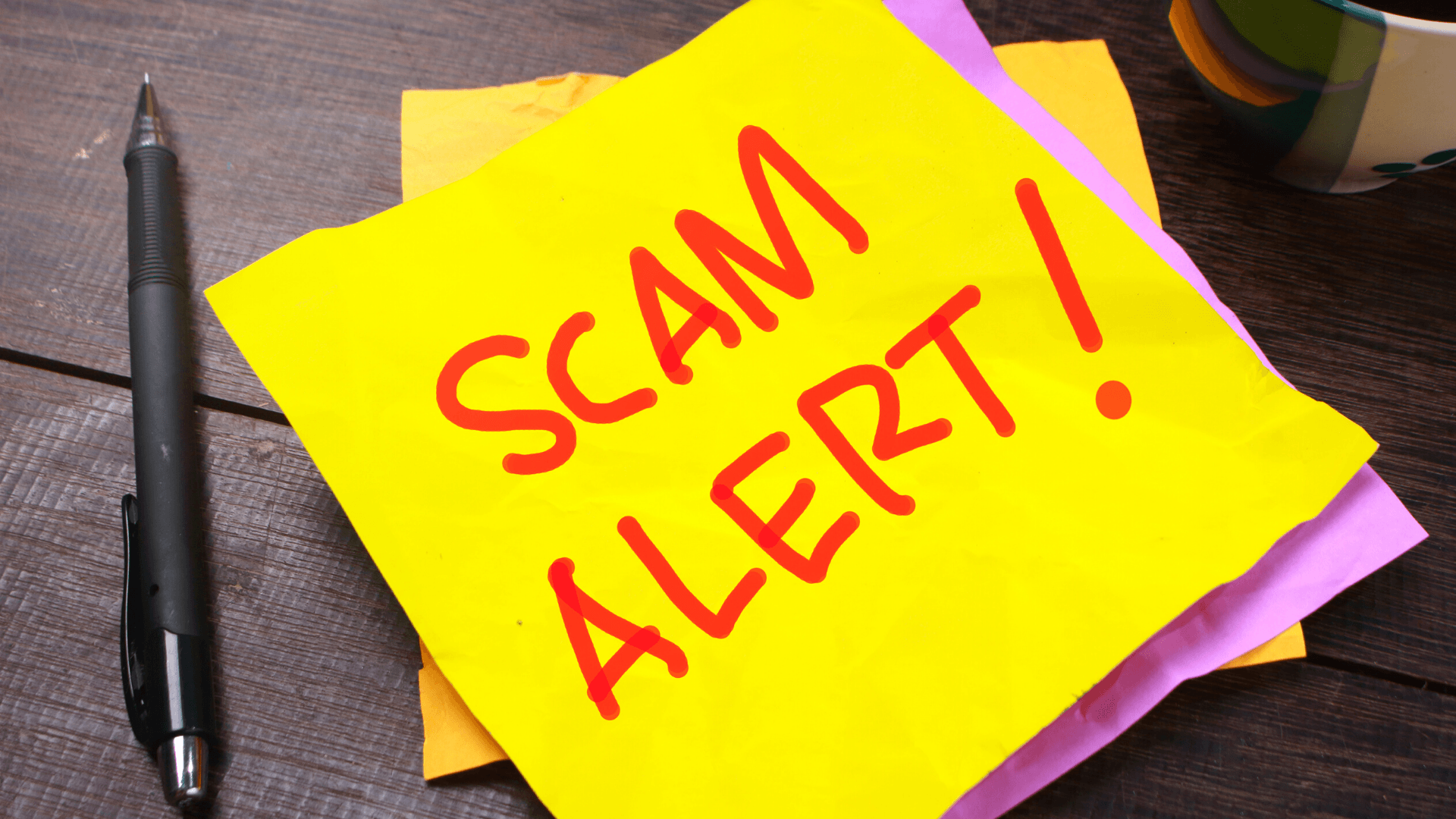 Scam Alert on Post-it note